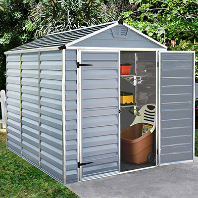 A grey, plastic shed with a skylight roof and a door open to reveal garden equipment