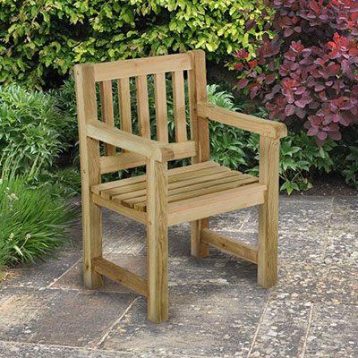 A simple wooden garden seat with armrests