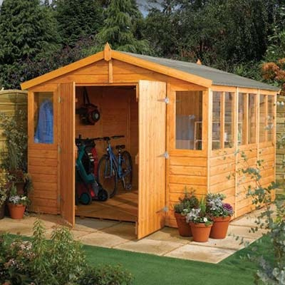 a wooden garden workshop with open double doors and a large number of windows