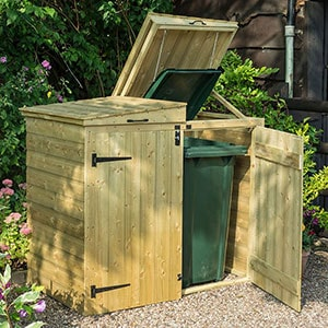 The 5'x2'7 Rowlinson Double Wheelie Bin Store, situated on a patio, with 1 door ajar.