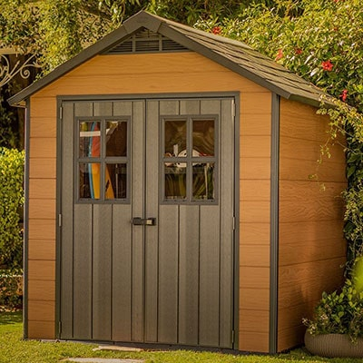 A plastic-wooden-hybrid shed with double doors and an apex roof