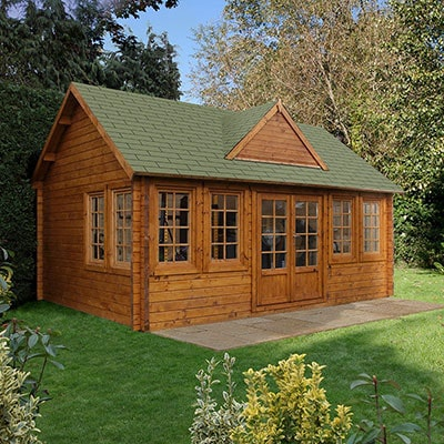 A log cabin with 44mm cladding, a shingle roof, double doors and 8 windows