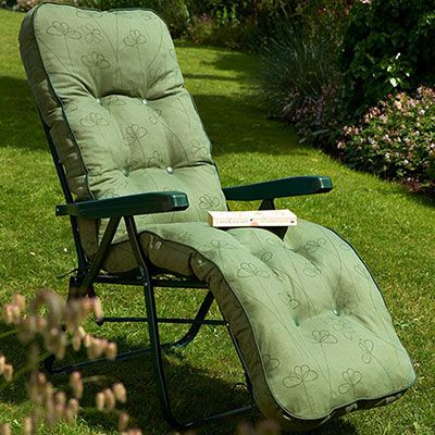 a relaxer garden chair with a green, patterned cushion