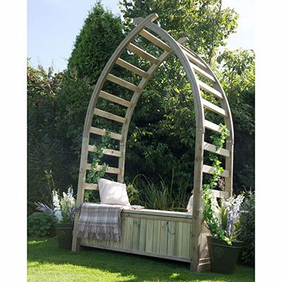 A garden arbour consisting of a curved arch and a wooden bench seat.