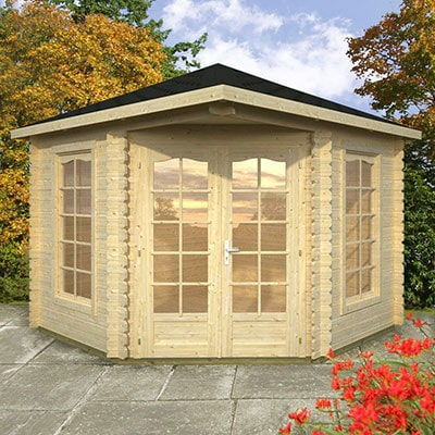 A cream corner summer house with glazed double doors and 2 full-length windows.