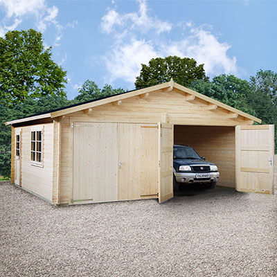 a large, wooden double garage, with a window and personal access door