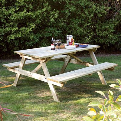 a 4ft wooden picnic bench, with condiments on the tabletop