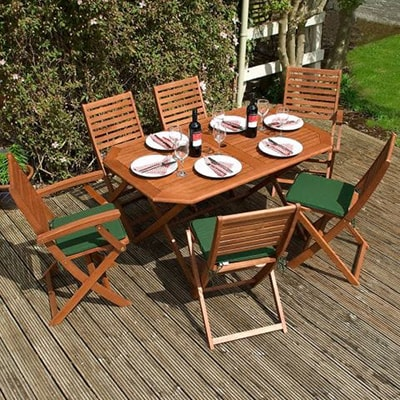 a fold-up, wooden garden dining set, consisting of a table and 6 chairs, each with a green seat pad