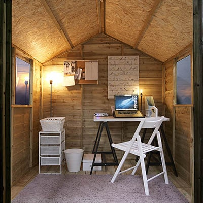 A solar lighting system with lamps and desk in a shed