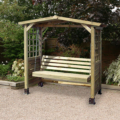 A wooden garden swing seat arbour with trellis sides.