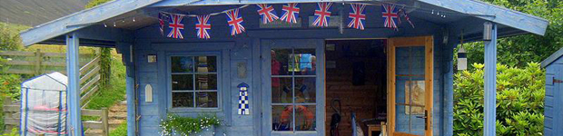 Blue shed with flags around